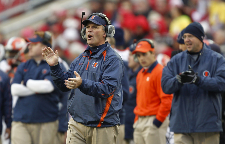 Photo -   Illinois coach Tim Beckman directs his team from the sidelines during the second half of an NCAA college football game against Illinois, Saturday, Oct. 6, 2012, in Madison, Wis. Wisconsin won 31-14. (AP Photo/Andy Manis)