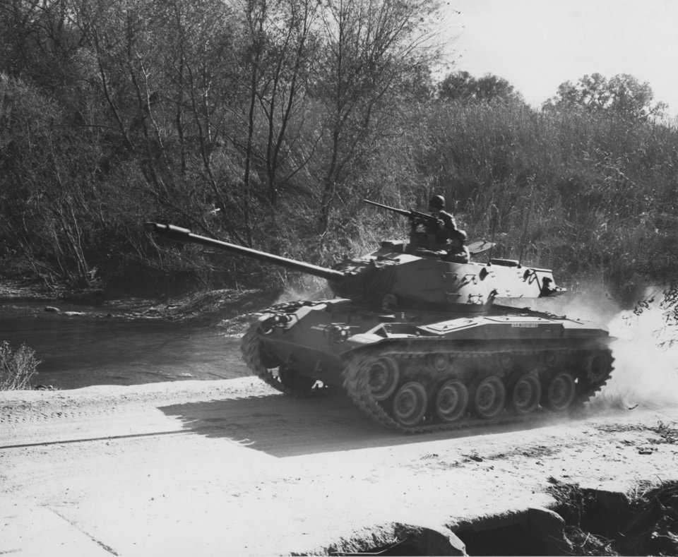 """Photo - Light Tanks Speed to the 'front' as 45th division Thunderbirds tested their platoons of the 2nd Reconnaissance Squadron, 245th Armor Saturday at Fort Sill.  This M-41 tank belongs to 1st Platoon of Troop B from Walters.  Some 250 guardsmen from Lawton, Walters, Waurika and Marlow are taking part in the 2-day test which continues Sunday until noon.  The 14-mile test pits the Thunderbirds against an aggressor force, under the grading eyes of umpires.""""  Credit 45th Division photo.  Original undated.  Published in The Daily Oklahoman 11/13/1960."""