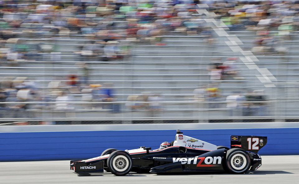 Photo - Will Power makes his way through turn four during the Milwaukee Mile IndyCar auto race Sunday, Aug. 17, 2014, in West Allis, Wis. (AP Photo/Morry Gash)