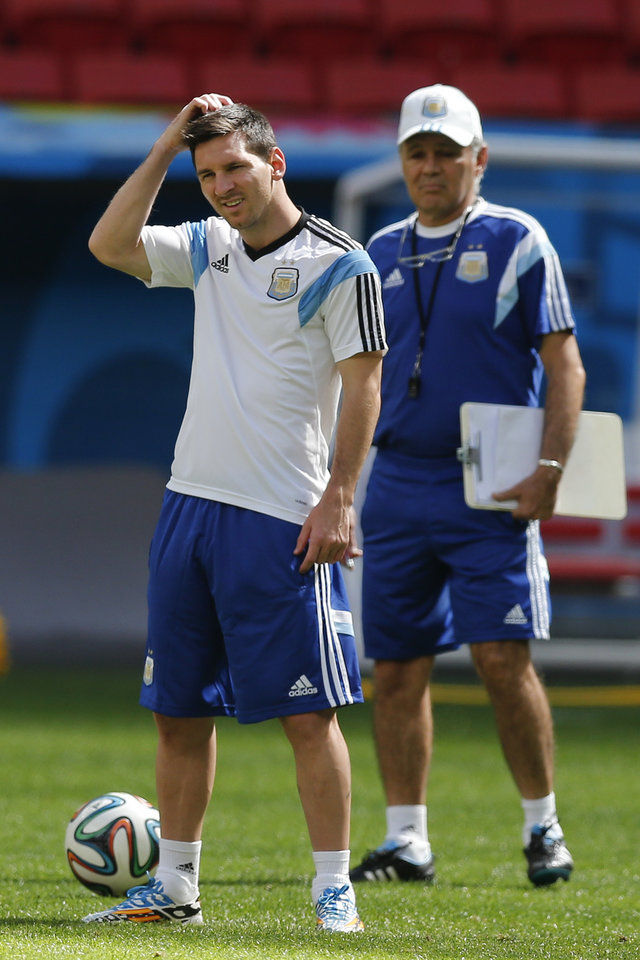 Photo - Argentina's Lionel Messi, left, stands next to Argentina's head coach Alejandro Sabella, right,   during a training session at Estadio Nacional in Brasilia, Brazil, Friday, July 4, 2014. On Saturday, Argentina will face Belgium in their World Cup quarterfinals soccer match. (AP Photo/Victor R. Caivano)