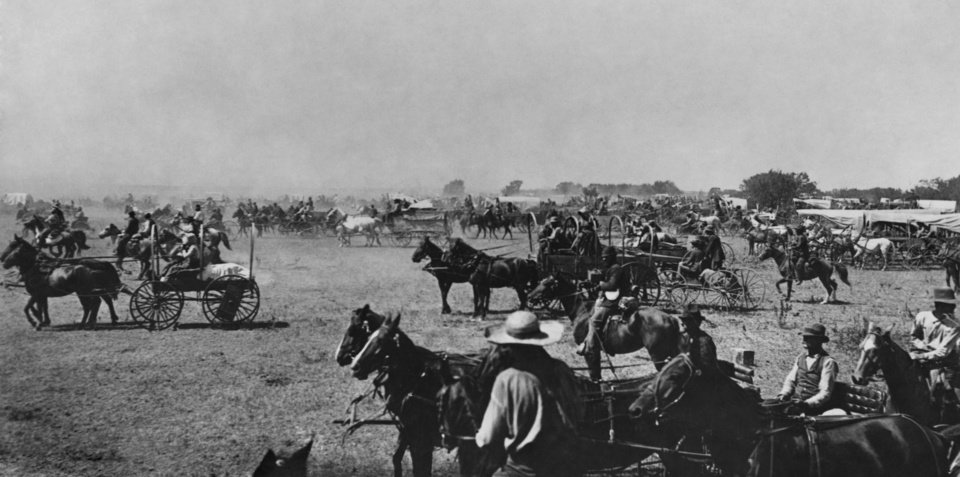 """EARLY DAYS / LAND RUN / HORSES / WAGONS / CHEROKEE STRIP / CHEROKEE OUTLET:  Caption reads, """"By the time Forbes changed his plate the racers were away, leaving the spectators at the post.""""  Caption on front [REMOVED] reads, """"THE START.  No. 150.""""  Original date 9/16/1893.  Photographer A.A. Forbes.  Published in The Daily Oklahoman on 9/11/1960."""