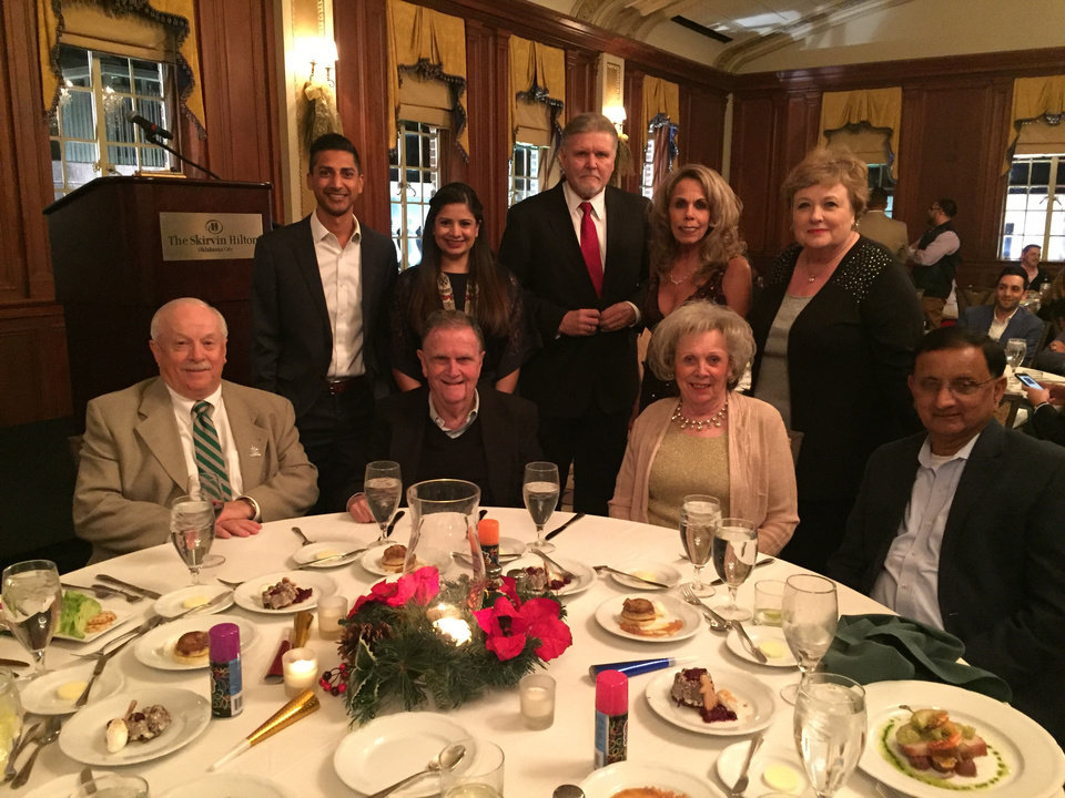 Photo -  ABOVE: Seated: Michael Carrier, Councilman Larry McAtee, Jo Ann McAtee, and Champ Patel. Standing: Harshil Patel, Trushna Patel, Robert Lewter, Delanna Lewter and Sharon Buchanan. [PHOTO PROVIDED]