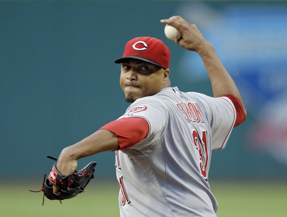 Photo - Cincinnati Reds starting pitcher Alfredo Simon delivers against the Cleveland Indians in the first inning of a baseball game Monday, Aug. 4, 2014, in Cleveland. (AP Photo/Mark Duncan)