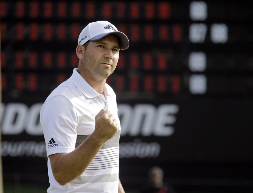 Photo - Sergio Garcia, from Spain, pumps his fist after a birdie on the 18th green dropped him to 11-under par after the second round of the Bridgestone Invitational golf tournament Friday, Aug. 1, 2014, at Firestone Country Club in Akron, Ohio. (AP Photo/Mark Duncan)