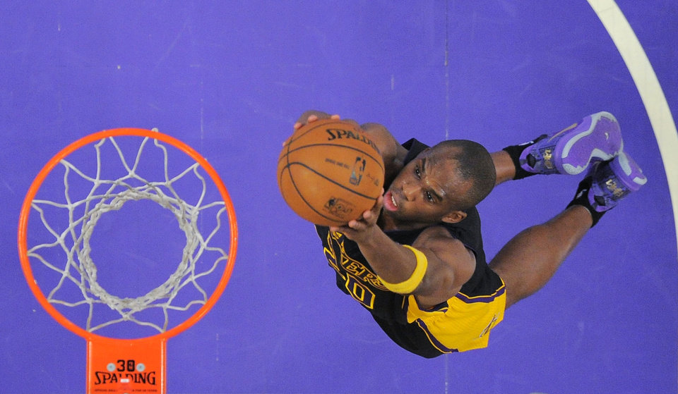 Photo - Los Angeles Lakers guard Jodie Meeks goes up for a dunk during the first half of an NBA basketball game against the Charlotte Bobcats, Friday, Jan. 31, 2014, in Los Angeles. (AP Photo/Mark J. Terrill)