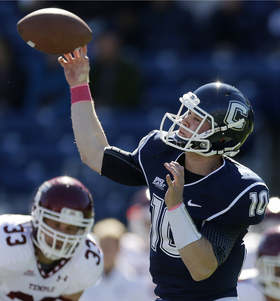 Connecticut quarterback Chandler Whitmer (10) passes in the first quarter of an NCAA football game against Temple in East Hartford, Conn., Saturday, Oct. 13, 2012. (AP Photo/Michael Dwyer)