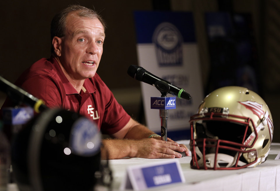 Photo - Florida State head coach Jimbo Fisher answers a question during a news conference at the Atlantic Coast Conference Football kickoff in Greensboro, N.C., Monday, July 21, 2014. (AP Photo/Chuck Burton)