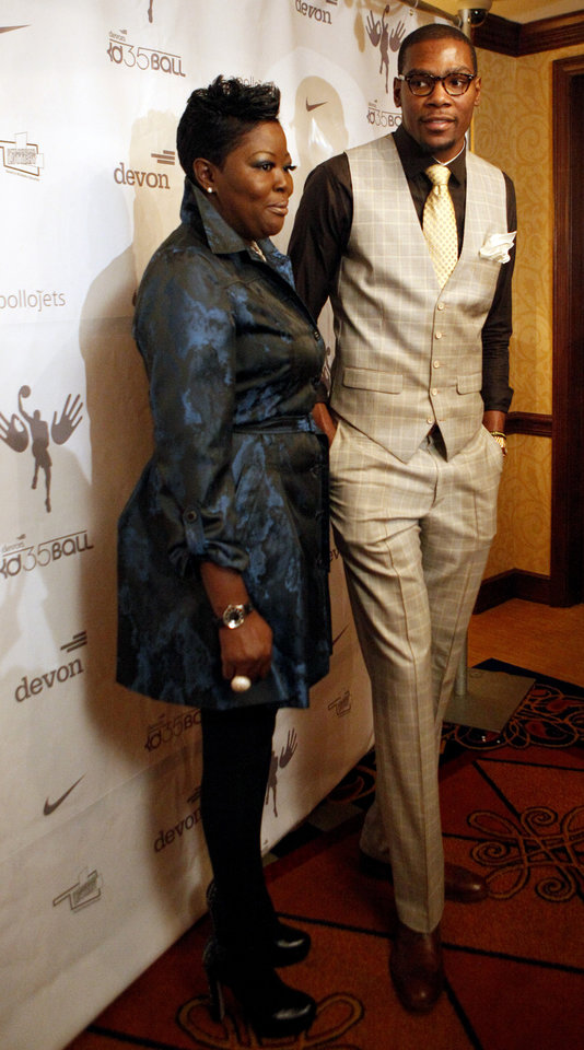 Photo - Oklahoma City Thunder's Kevin Durant and his mother, Wanda Pratt, speak to the media before the KD 35 Ball benefiting the Kevin Durant Family Foundation at the Skirvin Hilton Hotel in Oklahoma City, Saturday, March 31, 2012. Photo by Sarah Phipps The Oklahoman