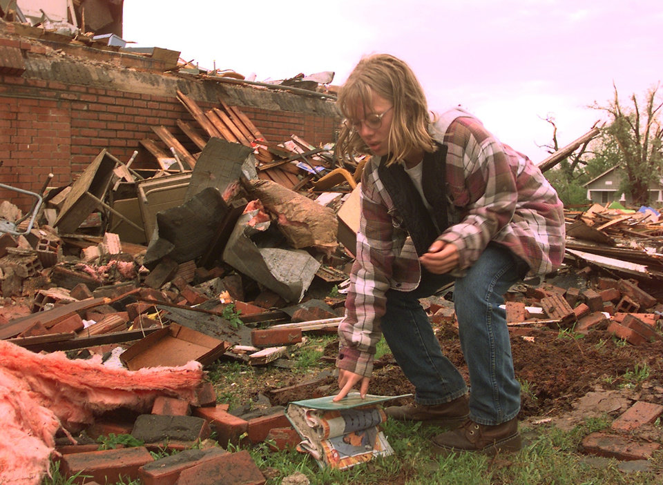 MAY 3, 1999 TORNADO: Tornado damage. Brooke Bulling, a fifth-grader at Mulhall School, sorts through damage at school.