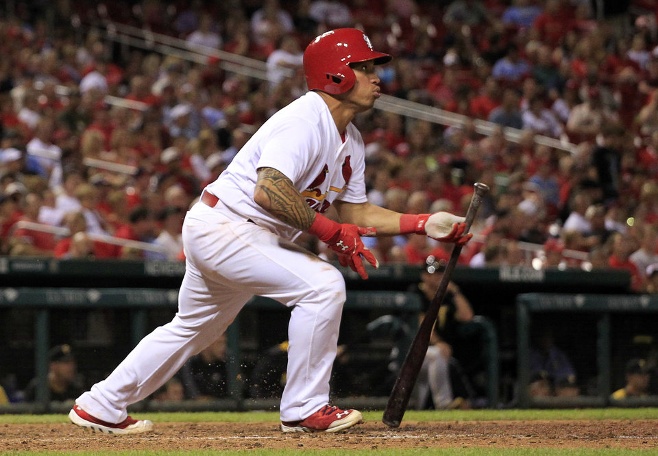 Photo - St. Louis Cardinals' Kolten Wong watches his solo home run during the seventh inning of a baseball game against the Pittsburgh Pirates Wednesday, July 9, 2014, in St. Louis. (AP Photo/Jeff Roberson)