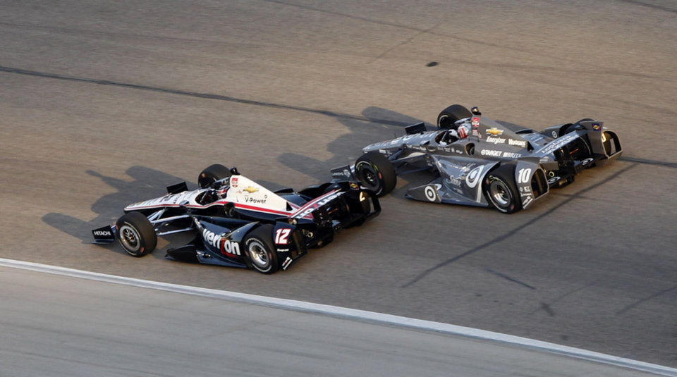 Photo - Will Power, left, of Australia, and Tony Kanaan, of Brazil, drive through a turn during the IndyCar auto race at Texas Motor Speedway in Fort Worth, Texas, Saturday, June 7, 2014. (AP Photo/Ralph Lauer)