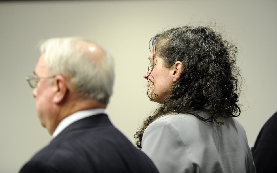 """Photo - Dee Dee Moore, right, reacts to the verdict along with Assistant Regional Counsel Byron Hileman after Moore was found guilty of first-degree murder in the death of lottery winner Abraham Shakespeare Monday, Dec. 10, 2012 in Tampa, Fla. Moore was convicted Monday of first-degree murder in the slaying of a lottery winner in central Florida and sentenced to mandatory life without parole by a judge who called her """"cold, calculating and cruel."""" (AP Photo/The Tampa Tribune, Chris Urso, Pool)"""