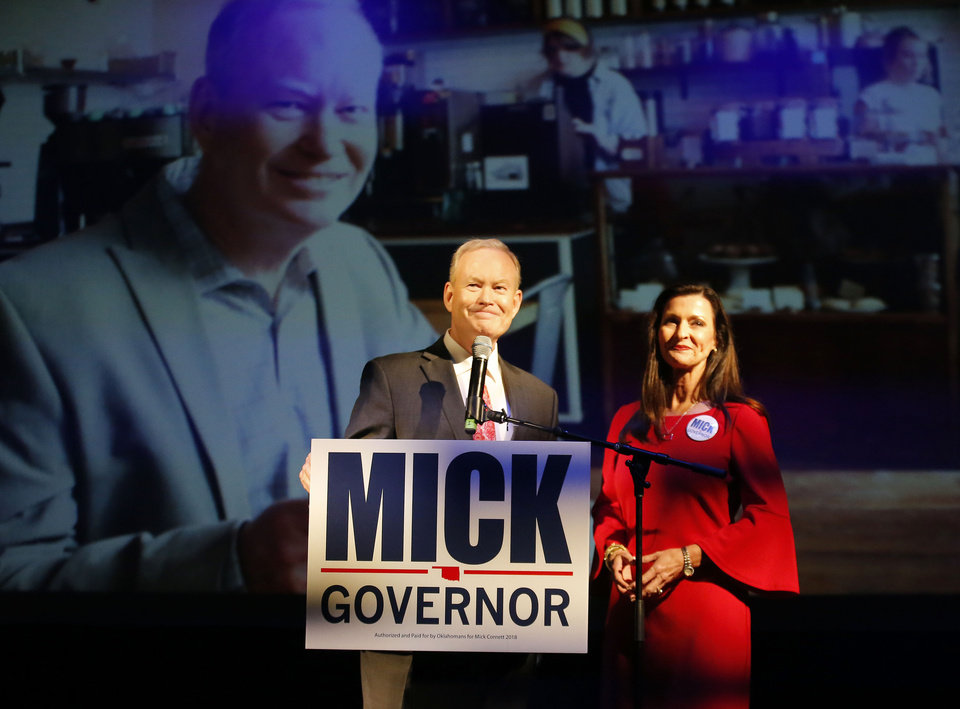 Photo - Mick Cornett gives a concession speech with his wifeTerri during a watch party at the Tower Theatre in Oklahoma City , Tuesday, Aug. 28, 2018. Photo by Sarah Phipps, The Oklahoman