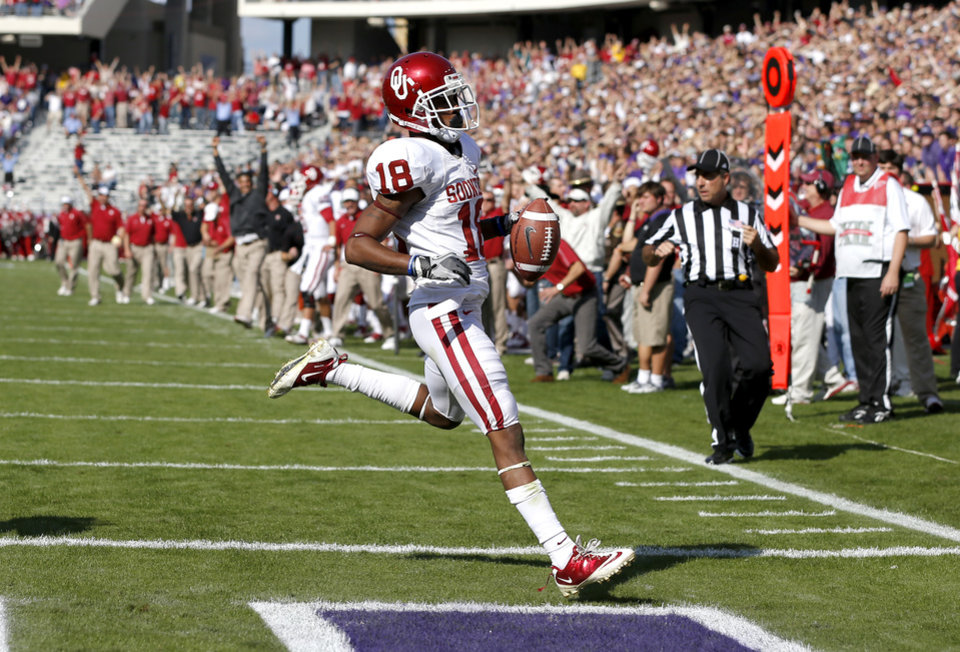 Oklahoma's Jalen Saunders (18) scores a touchdown during a college football game between the University of Oklahoma Sooners (OU) and the Texas Christian University Horned Frogs (TCU) at Amon G. Carter Stadium in Fort Worth, Texas, Saturday, Dec. 1, 2012. Oklahoma won 24-17. Photo by Bryan Terry, The Oklahoman