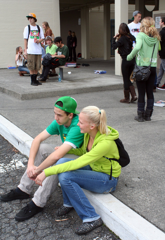 In this photo provided by the Arcata High School Pepperbox, Arcata High School students wear green colored clothing in tribute to fellow student Gregory Kulijan Monday, Nov. 26, 2012, at Arcata High School in Arcata, Calif. The Kuljian family were out for a walk Saturday, Nov. 24 at Big Lagoon beach, playing fetch with their dog when Gregory Kuljian tossed a stick that took their dog down to the water\'s edge. Kuljian\'s son ran to save the dog, and struggled as he was captured by the surging surf. Howard Kuljian followed, and later his wife. Both parents\' bodies were later recovered, but the boy, presumed dead, is still missing. (AP Photo/Arcata High School Pepperbox, Forrest Lewis)