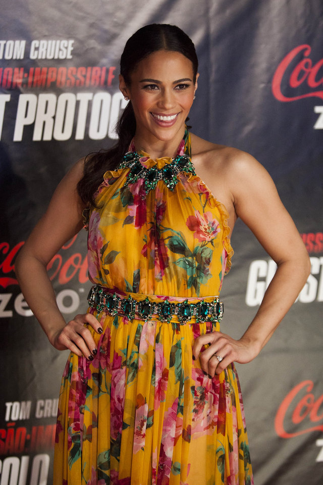 U.S actress Paula Patton poses for pictures as she arrives on the red carpet for the Premiere of Mission Impossible Ghost Protocol in Rio de Janeiro, Brazil, Wednesday Dec.  14, 2011. (AP Photo/Felipe Dana) ORG XMIT: XFD111