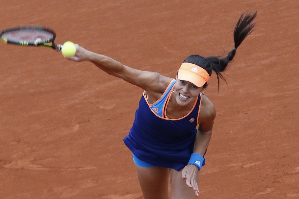 Photo - Serbia's Anna Ivanovic serves the ball during the second round match of the French Open tennis tournament against Ukraine's Elina Svitolina at the Roland Garros stadium, in Paris, France, Thursday, May 29, 2014. (AP Photo/Darko Vojinovic)