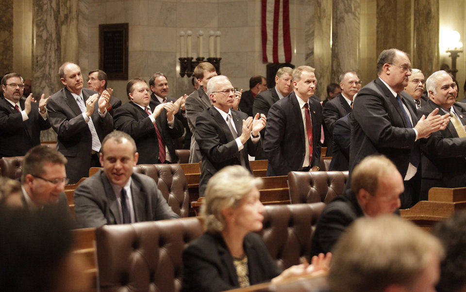 Wisconsin Republican state legislators applaud a proposal made by Governor Scott Walker during his state budget address while their Democratic counterparts remain seated during that portion of the speech at the Wisconsin State Capitol in Madison, Wis. Wednesday, February 20, 2013. (AP Photo/Wisconsin State Journal, John Hart)
