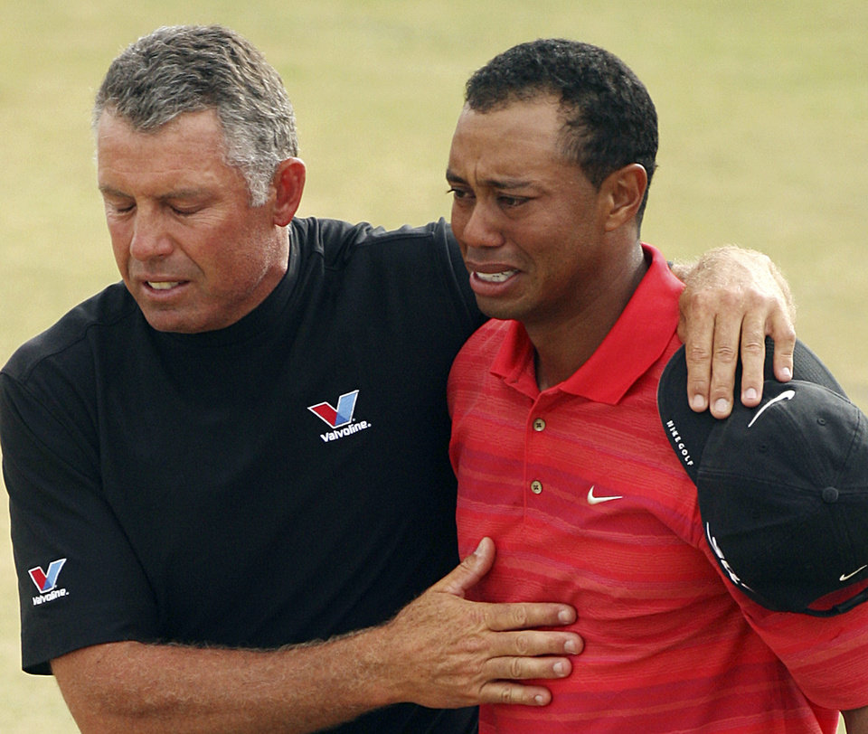Photo - FILE - In this July 23, 2006, file photo, Tiger Woods, of the United States, right, reacts as he walks off the 18th green with his caddie Steve Williams after winning the British Open Golf Championship at the Royal Liverpool Golf Course in Hoylake, England. The British Open golf championship returns to Royal Liverpool on Thursday July 17, 2014. (AP Photo/Alessia Pierdomenica, Pool, File)