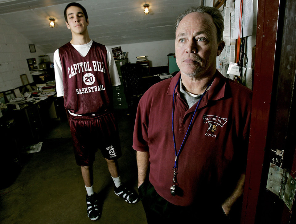 Photo - Capitol Hill High School's head basketball coach Donny Tuley poses with Remey Boswell in the coach's office at The Dome at Capitol Hill High School in Oklahoma City, Okla., Tuesday, Jan. 22, 2007. By John Clanton, The Oklahoman ORG XMIT: KOD