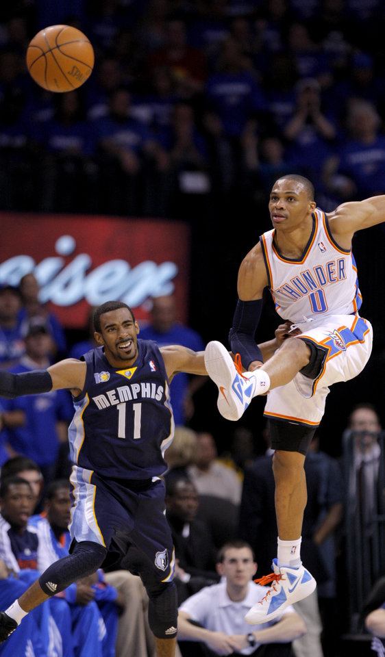 Oklahoma City's Russell Westbrook (0)knocks the ball away from Mike Conley (11) of Memphis during game two of the Western Conference semifinals between the Memphis Grizzlies and the Oklahoma City Thunder in the NBA basketball playoffs at Oklahoma City Arena in Oklahoma City, Tuesday, May 3, 2011. Photo by Bryan Terry, The Oklahoman