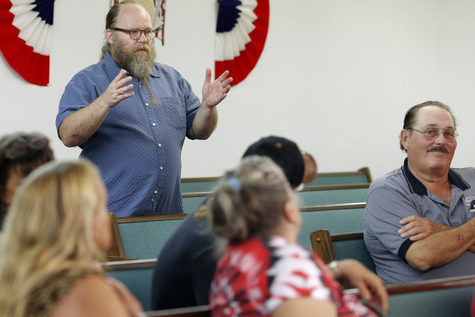 John Zumwalt, husband of Joe's Addiction coffee shop owner Jamie Zumwalt, speaks Tuesday, May 14, 2013, about a motion to not renew the business license for Joe's Addiction by the town's Board of Trustees during a meeting in Valley Brook. Photo by Bryan Terry, The Oklahoman <strong>Bryan Terry - THE OKLAHOMAN</strong>