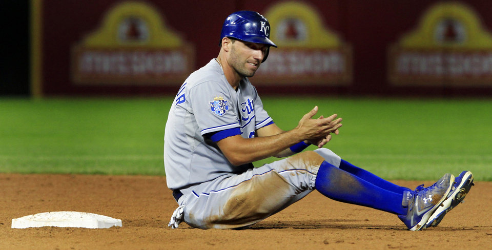 Photo -   Kansas City Royals' Jeff Francoeur sits in the dirt at second base after getting caught in a double play to end a baseball game against the Chicago White Sox, Monday, Aug. 6, 2012, in Chicago. The White Sox won 4-2. (AP Photo/John Smierciak)