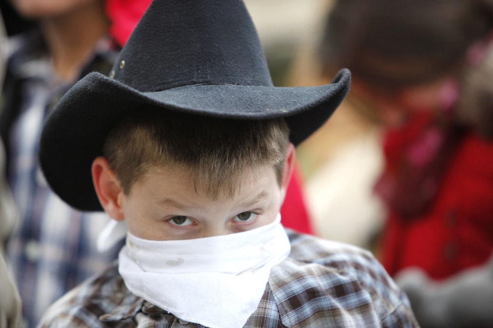 Fourth-grader Izzi Gibbs is dressed as a cowboy for the Oklahoma History Center chuckwagon's visit to Lincoln Elementary School.