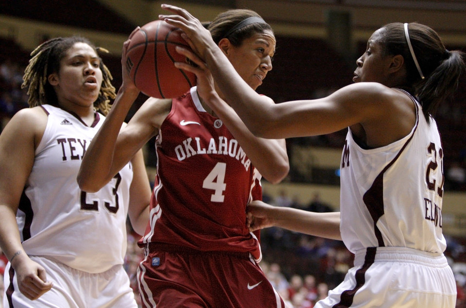 Photo - OU's Nicole Griffin (4) tries to get from between Texas A&M's Danielle Adams (23) and Adaora Elonu (21) during the women's college basketball Big 12 Championship tournament game between the University of Oklahoma and Texas A&M in Kansas City, Mo., Friday, March 11, 2011.  Photo by Bryan Terry, The Oklahoman