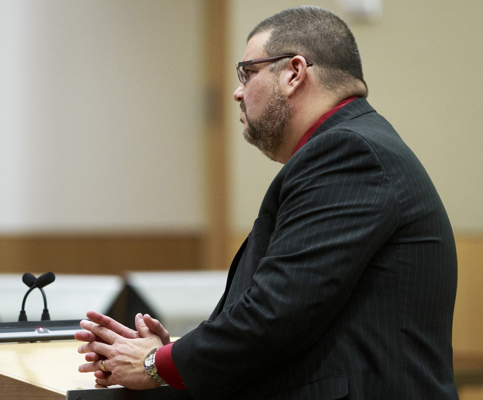 Defense Attorney Kirk Nurmi questions defendant Jodi Arias as she testifies during her murder trial in Phoenix, Tuesday, Feb. 5, 2013.  Arias is accused of murdering her lover Travis Alexander.   (AP Photo/The Arizona Republic, Charlie Leight)
