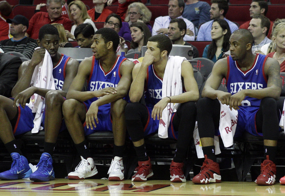 Photo - From left to right, Philadelphia 76ers' Henry Sims, Hollis Thompson, Michael Carter-Williams and James Anderson watch the final minutes during the second half of an NBA basketball game against the Houston Rockets, Thursday, March 27, 2014, in Houston. Houston won 120-98. (AP Photo/Bob Levey)
