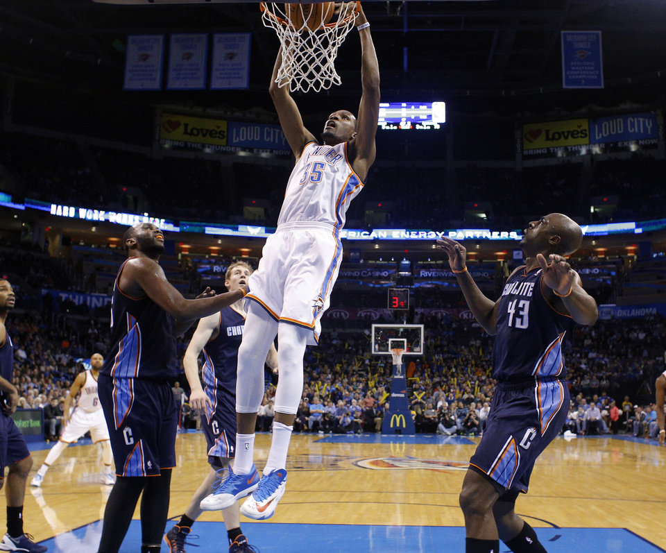 Photo - Oklahoma City 's Kevin Durant (35) dunks the ball during the NBA basketball game between the Oklahoma City Thunder and the Charlotte Bobcats at the Chesapeake Energy Arena, Sunday, March 2, 2014. Photo by Sarah Phipps, The Oklahoman