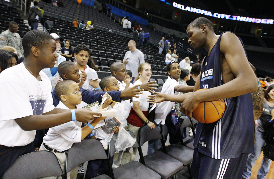 Oklahoma City's Kevin Durant slaps hands with fans after the open practice for the Oklahoma City Thunder NBA basketball team at the Ford Center in Oklahoma City, Monday, October 20, 2008. BY NATE BILLINGS, THE OKLAHOMAN