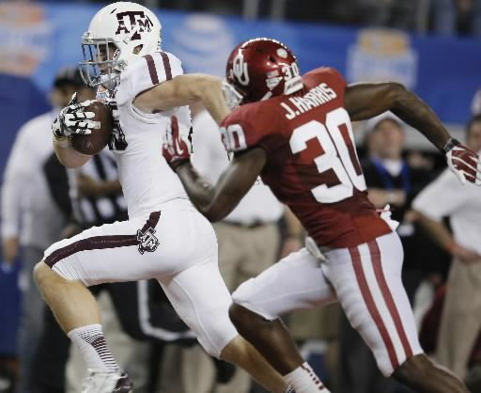 Texas A&M\'s Mike Evans (13) runs for a touchdown past Oklahoma\'s Javon Harris (30) during the college football Cotton Bowl game between the University of Oklahoma Sooners (OU) and Texas A&M University Aggies (TXAM) at Cowboys Stadium on Friday Jan. 4, 2013, in Arlington, Tx. Photo by Chris Landsberger, The Oklahoman