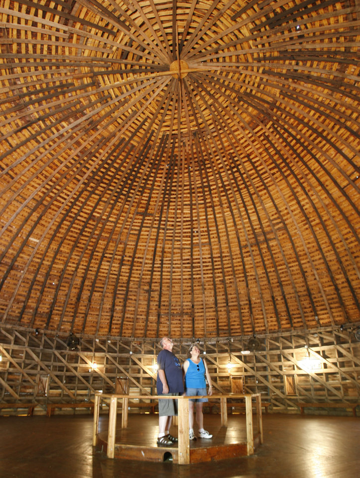 ROUTE 66: Topeka, KS residents Fred Zander and Candy Trapp look at the structure of the Round Barn in Arcadia, Okla., Thursday, June 21, 2007. Photo by Paul Hellstern / The Oklahoman.