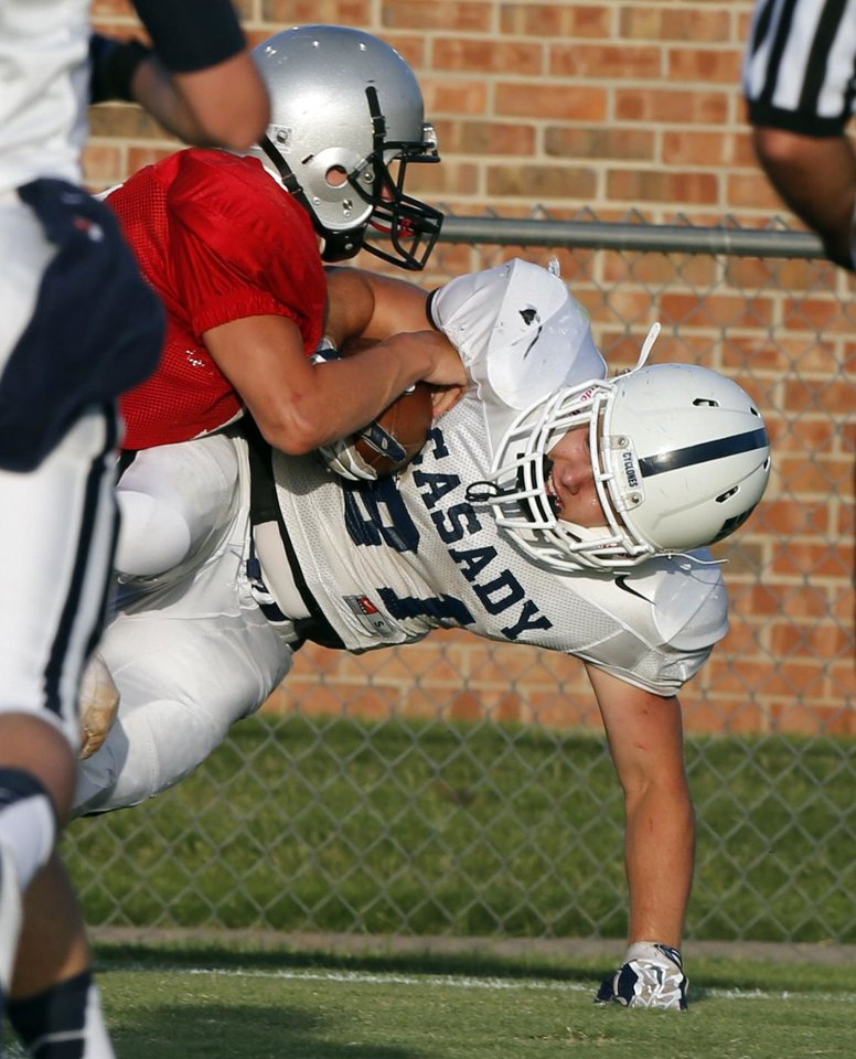 Photo - Casady's Jay Bozalis scores after a catche in play against Grant Hich School during at a high school football scrimmage at Casady School in Oklahoma City, Okla., on Friday, Aug. 22, 2014. Photo by Steve Sisney, The Oklahoman