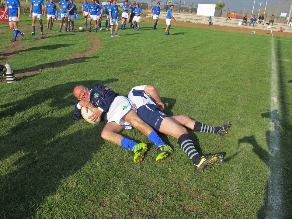 "Former member of Uruguay's rugby team Alfredo Daniel Delgado Salaberri, who also goes by ""Pancho,"" left, scores the first try during a rugby game with Chile's former players as they mark the 40th anniversary of their plane crash in Santiago, Chile, Saturday, Oct. 13, 2012. Uruguay's former rugby players marked the 40 year anniversary since they survived 72 days in the Chilean Andes after their plane crashed in 1972. Only 16 of the 45 passengers aboard survived, by feeding on dead passengers preserved in the snow. (AP Photo/Luis Andres Henao)"