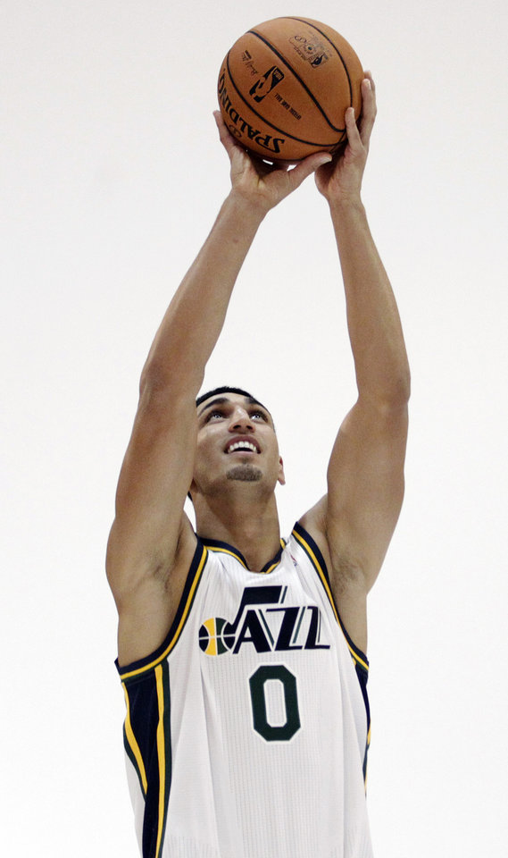 Photo -   Utah Jazz's Enes Kanter (0) poses for a photograph during their NBA basketball media day, Monday, Oct. 1, 2012, in Salt Lake City. (AP Photo/Rick Bowmer)