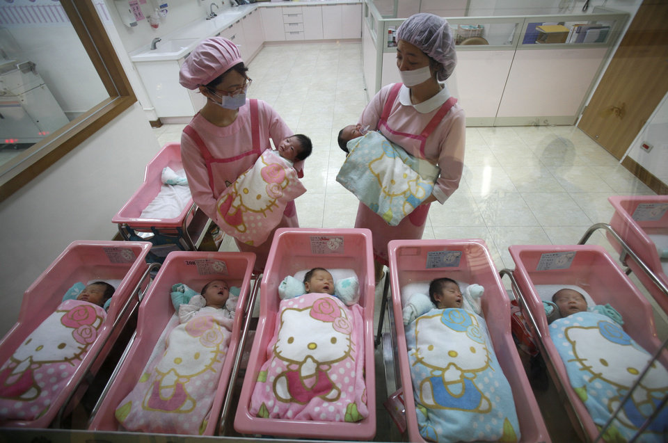 Photo - FILE - In this Jan. 20, 2009 file photo, nurses check on newborns, at the Hello Kitty-designed maternity ward, at the Hau Sheng hospital in the southern Taiwan city of Chunghua. Five years after the deepest global recession since the 1930s sent birth rates plunging around the world, many couples are still not having children. That's good news if you're worried about an overcrowded planet. But it's bad for the economy. (AP Photo/Wally Santana, File)