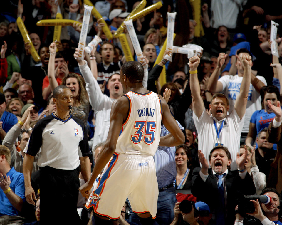 Photo - The crowd reacts after Oklahoma City's Kevin Durant (35) dunked the ball during the NBA basketball game between the Oklahoma City Thunder and the Golden State Warriors at the Oklahoma City Arena, Tuesday, March 29, 2011. Photo by Bryan Terry, The Oklahoman