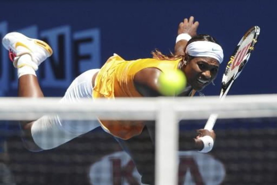 Serena  Williams of the U.S., serves to Li Na of China during her Women's singles semifinal match at the Australian Open tennis tournament in Melbourne, Australia, Thursday, Jan. 28, 2010. (AP Photo/Paul Crock, Pool)