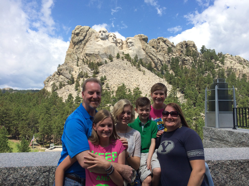 Photo -       Columnist Greg Kratz and his family enjoy a visit to Mount Rushmore National Memorial in South Dakota on July 12. Mount Rushmore is a famous South Dakota landmark, and its faces also teach a valuable lesson in work-life balance.