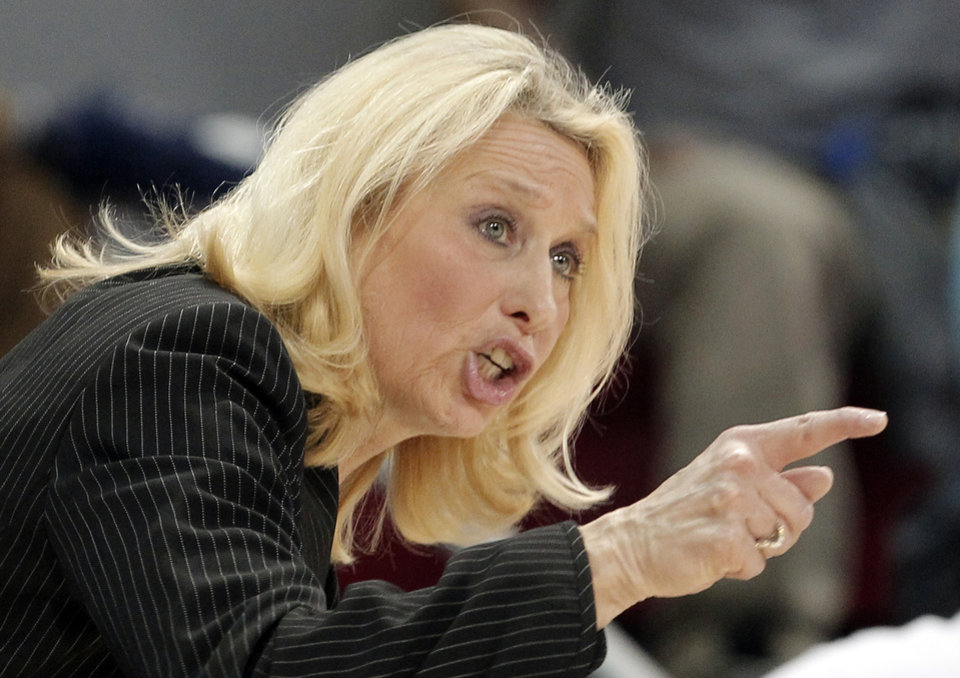 Photo - SMU head coach Rhonda Rompola calls out a play in the first half of an NCAA college basketball game against Louisville, Sunday, Jan. 19, 2014, in Dallas. (AP Photo/Brandon Wade)