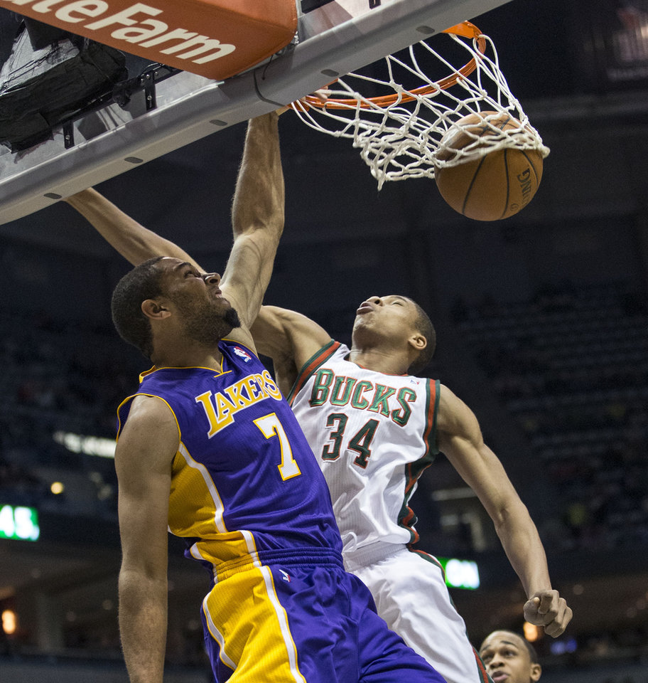 Photo - Milwaukee Bucks' Giannis Antetokounmpo can not stop Los Angeles Lakers' Xavier Henry from dunking the ball during the first half of an NBA basketball game Thursday, March 27, 2014, in Milwaukee. (AP Photo/Tom Lynn)
