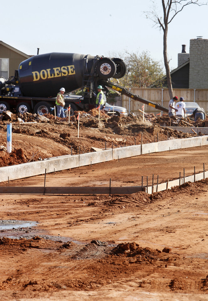 Photo - Construction crews work to pour streets for Glenbrook Park, a new housing addition under way on the north side of NW 63 between Pennsylvania and Grand avenues in Nichols Hills.  Photo by PAUL B. SOUTHERLAND, The Oklahoman