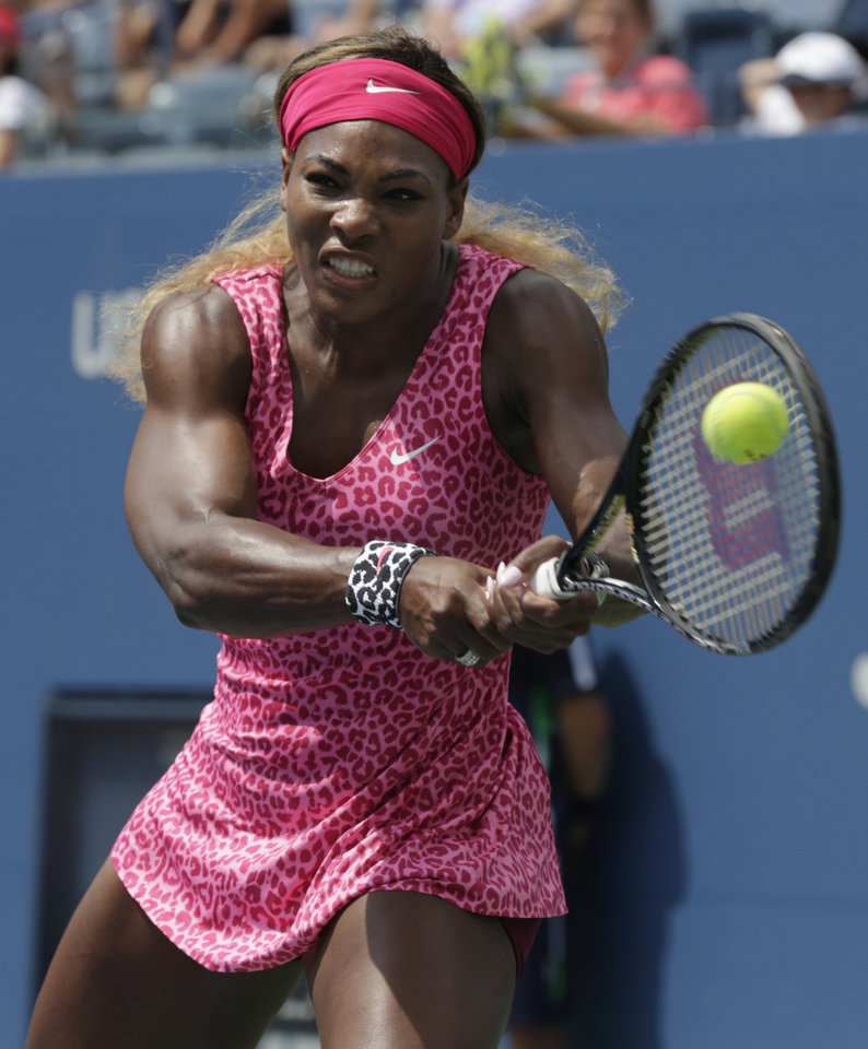Photo - Serena Williams, of the United States, returns a shot to Kaia Kanepi, of Estonia, during the fourth round of the 2014 U.S. Open tennis tournament, Monday, Sept. 1, 2014, in New York. (AP Photo/Charles Krupa)