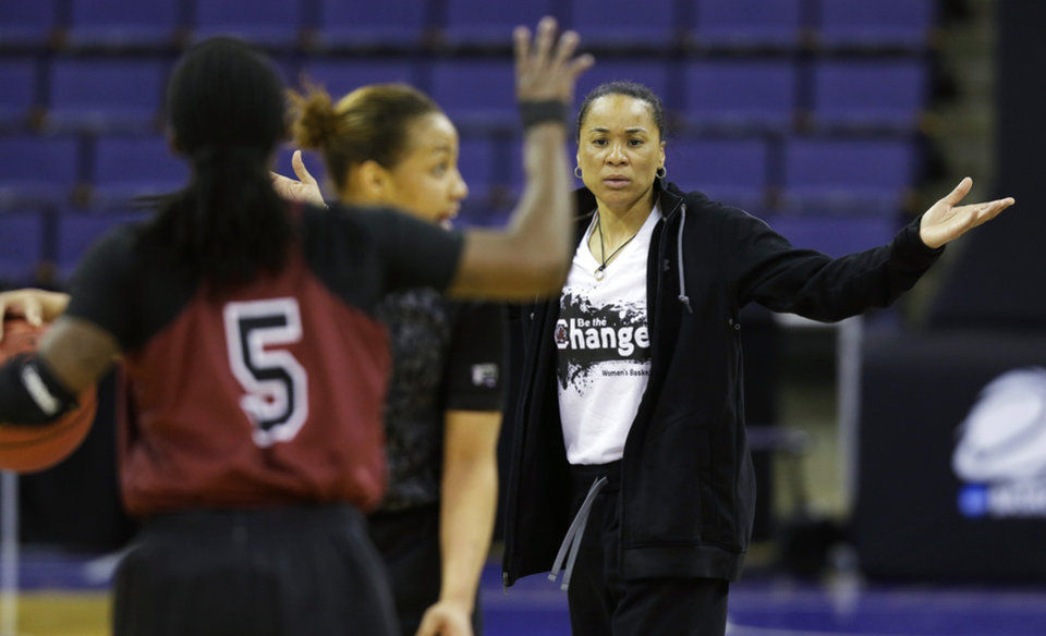 Photo - South Carolina head coach Dawn Staley, right, gestures toward her players as they practice during the NCAA women's college basketball tournament, Saturday, March 22, 2014, in Seattle. South Carolina is scheduled to play Cal State Northridge in a first-round game on Sunday. (AP Photo/Ted S. Warren)