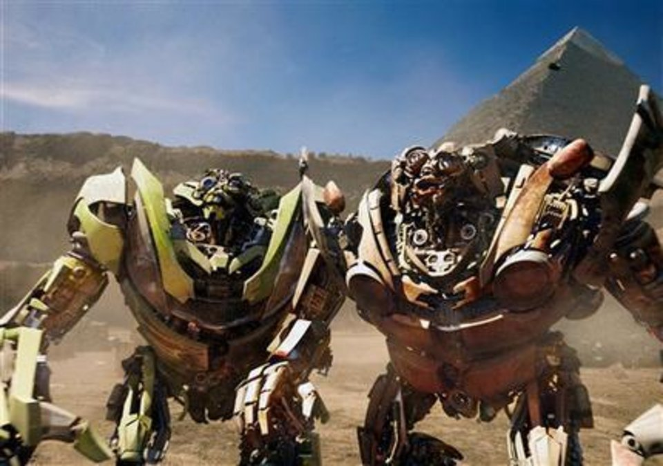 """In this film publicity image released by Paramount Pictures, twin robots, Skids, left, and Mudflap are shown in a scene from, """"Transformers: Revenge of the Fallen. AP Photo"""