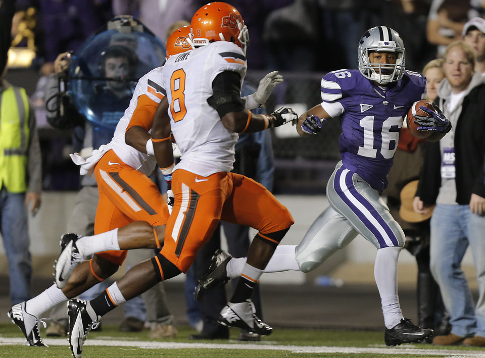 Photo - Kansas State's Tyler Lockett (16) rushes down the sideline past Oklahoma State's Daytawion Lowe (8) during the college football game between the Oklahoma State University Cowboys (OSU) and the Kansas State University Wildcats (KSU) at Bill Snyder Family Football Stadium on Saturday, Nov. 1, 2012, in Manhattan, Kan. Photo by Chris Landsberger, The Oklahoman