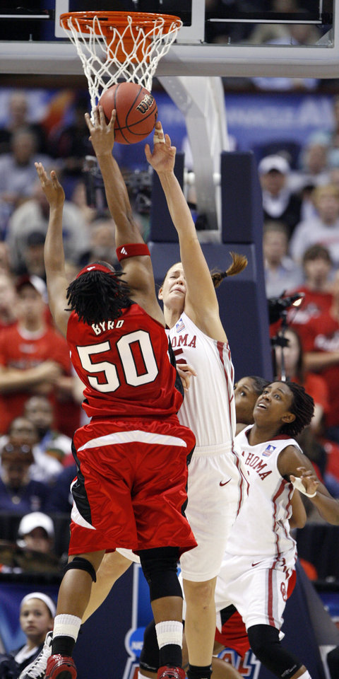 Photo - Whitney Hand blocks a shot by Deseree' Byrd in the second half as the University of Oklahoma plays Louisville at the 2009 NCAA women's basketball tournament Final Four in the Scottrade Center in Saint Louis, Missouri on Sunday, April 5, 2009. 